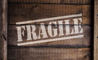 A wooden crate with the word fragile written on it as you will need it to pack fragile items when moving.